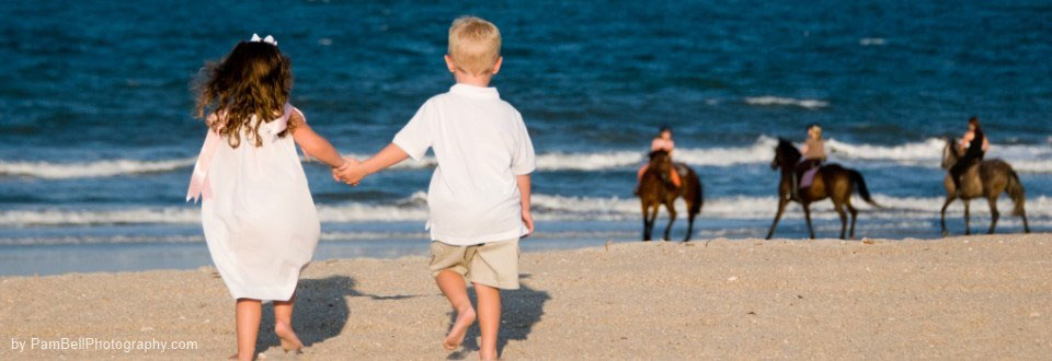 kids-and-horses-on-beach-960
