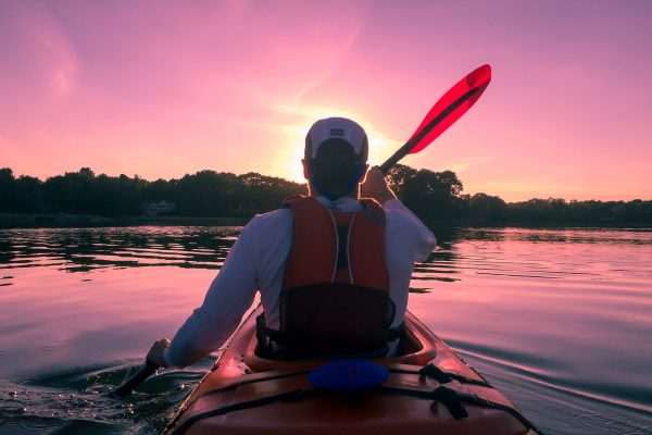 Man kayaking into the sunset || Top 3 Kayak Companies of Amelia Island