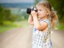 young-girl-holding-a-camera